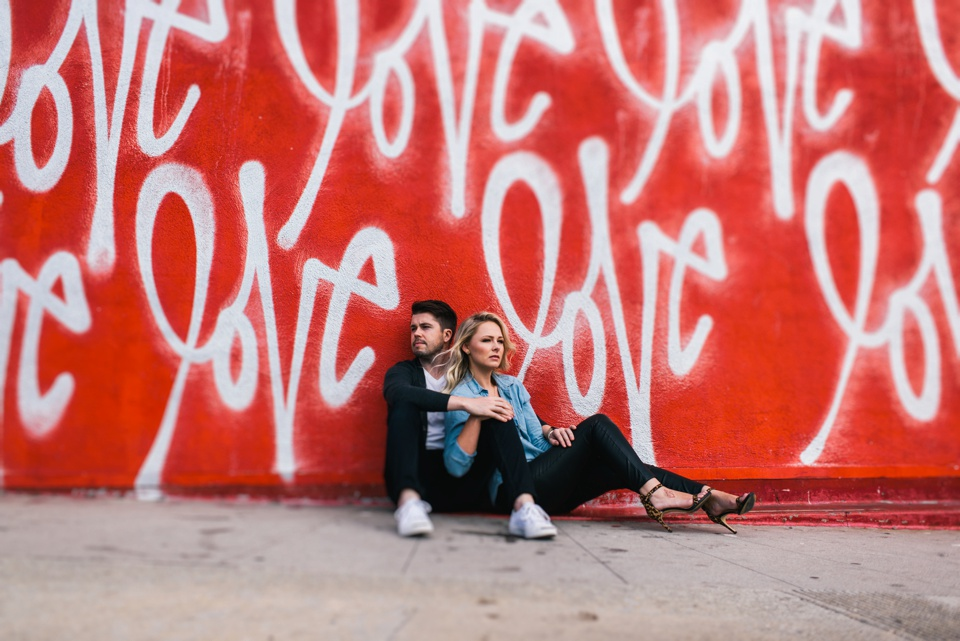 love wall engagement photo