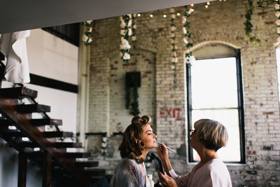 maid of honor getting makeup on