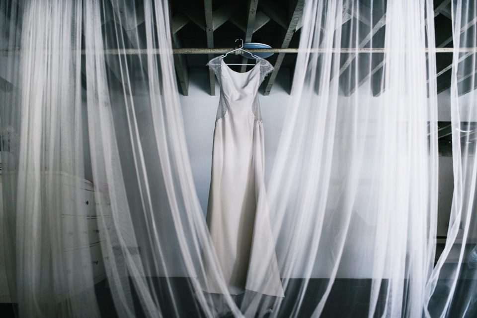 brides dress hanging in DTLA loft