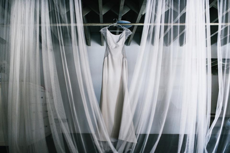 brides dress hanging in DTLA loft