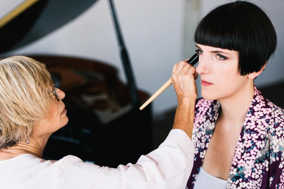 bride having makeup done in DTLA loft