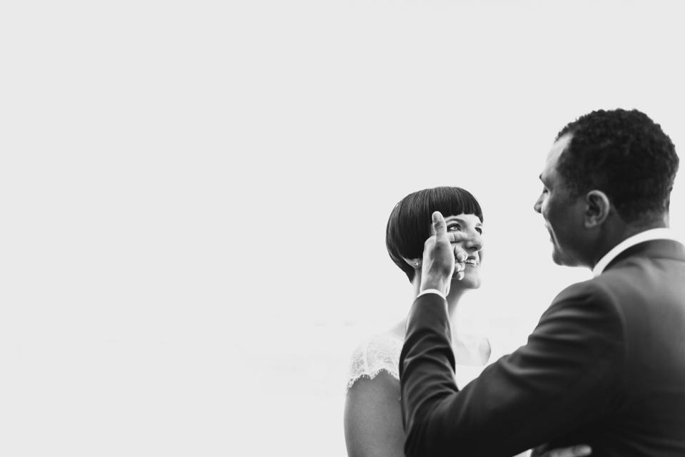 groom wipes tear from brides eye