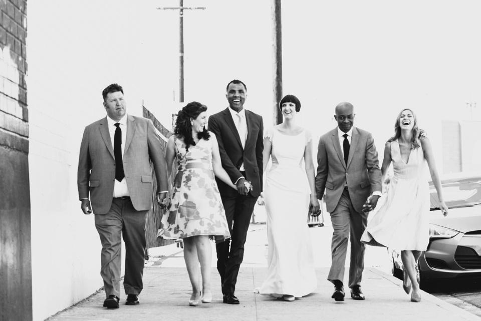 bridal party walk down street