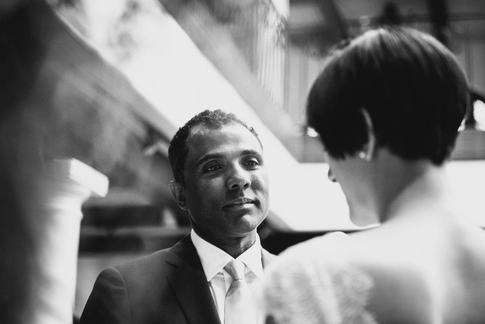 groom looks lovingly at bride