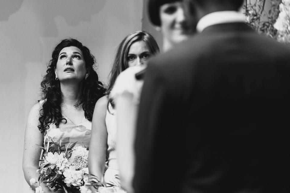 bridesmaid looks to the sky as emotions take hold