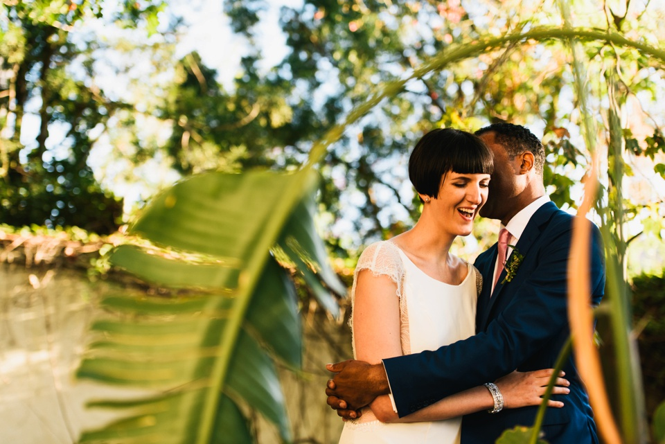 happy bride and groom at LA river center and gardens wedding