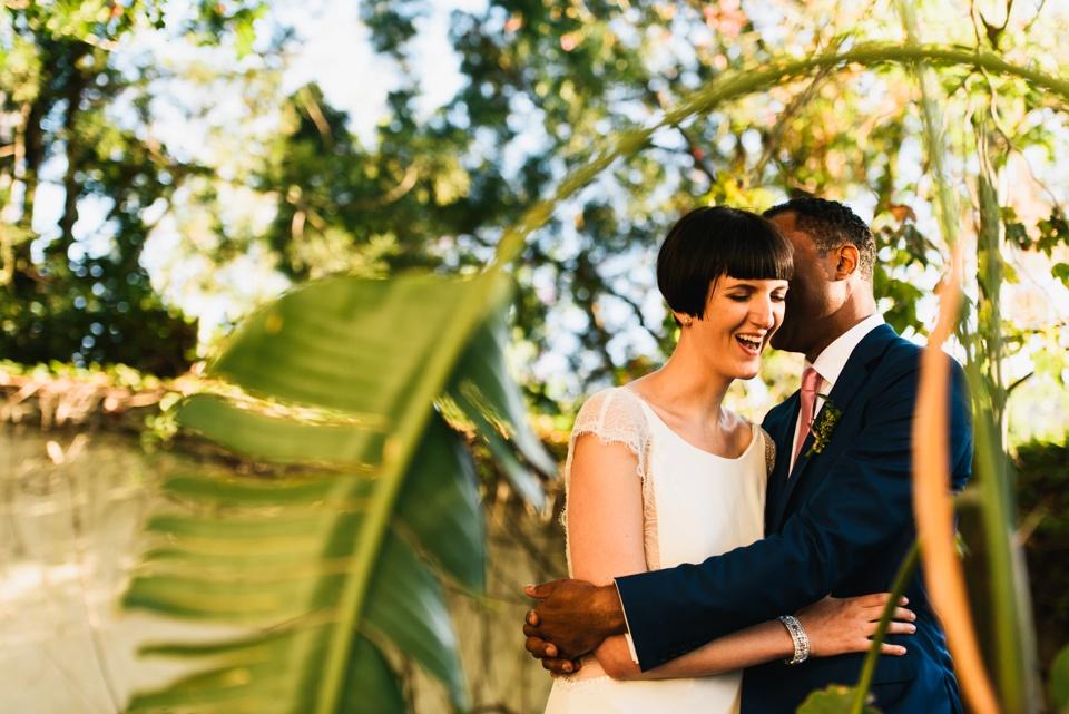 happy bride and groom at LA river center and gardens wedding