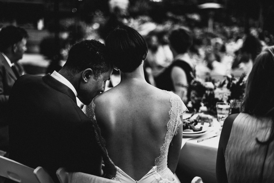 tender kiss from groom on the brides shoulder