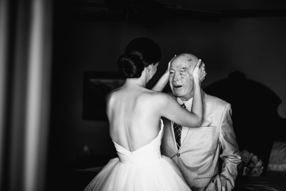 bride wipes tears from fathers face
