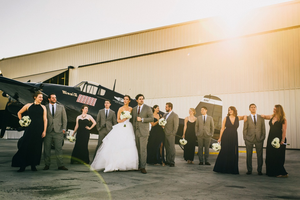 camarillo airport wedding group portrait in front of planes