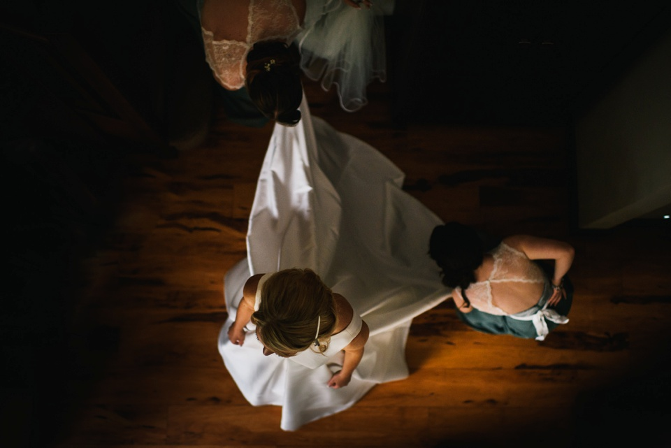 overhead of bride getting dressed