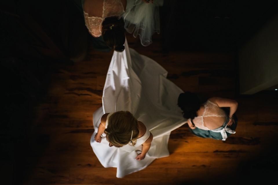 overhead of bride getting dressed