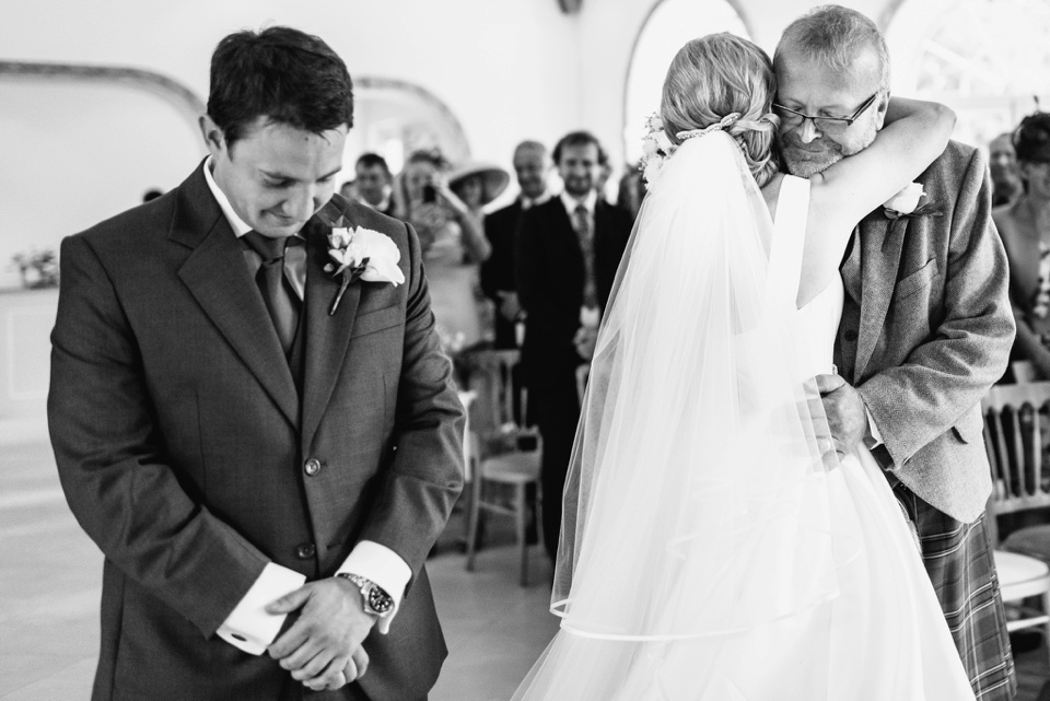father of bride gives away daughter
