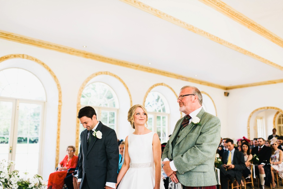 knowing look between bride and father