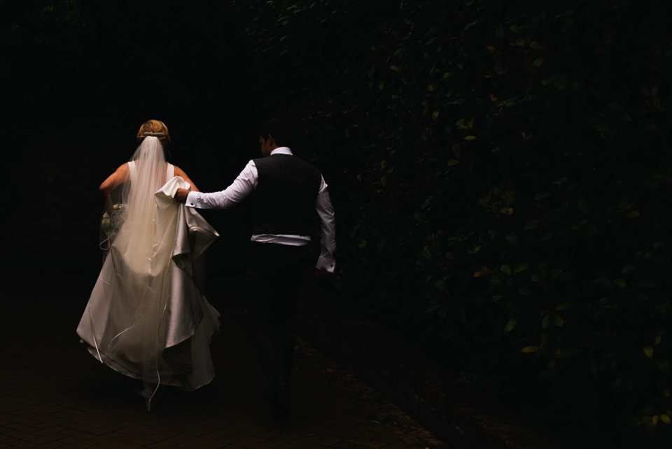 bride and groom head to reception