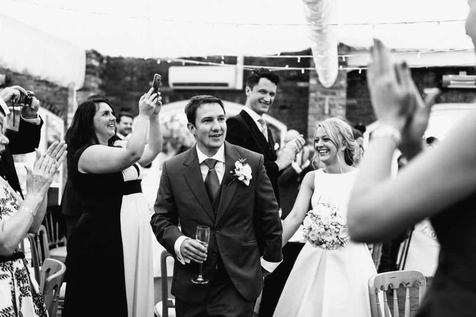 smiling couple enter reception