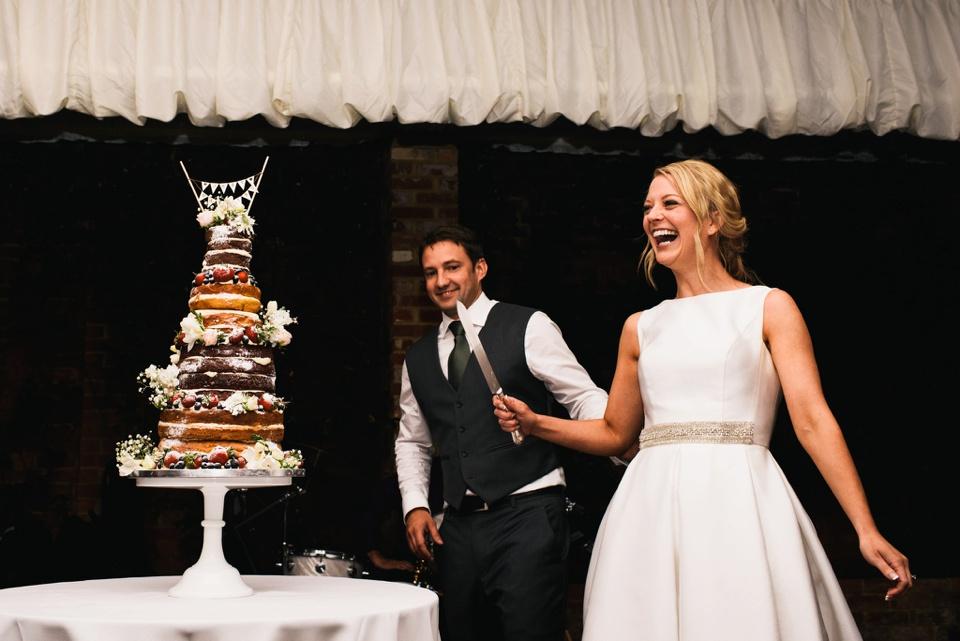 cutting cake Northbrook Park wedding