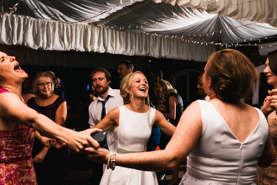 bride dances with friends