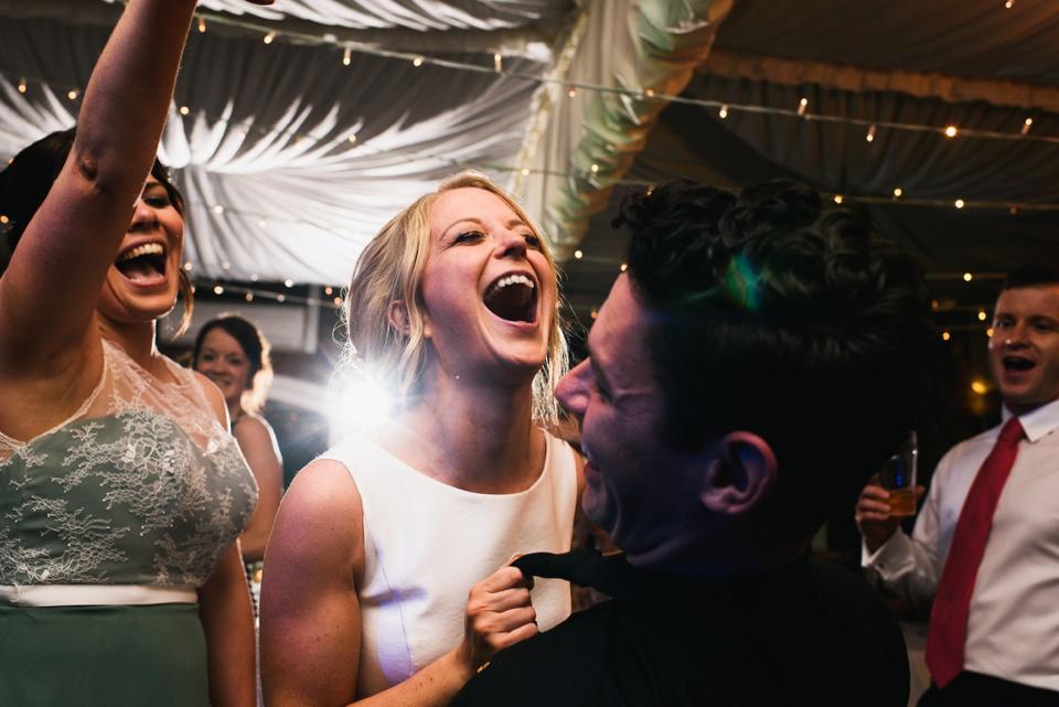 ecstatic bride dances with friends