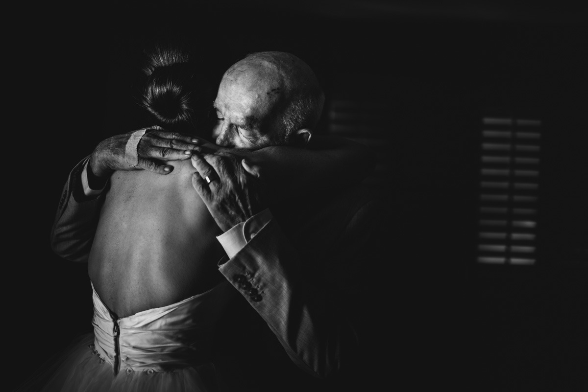 dad hugs daughter on her wedding day
