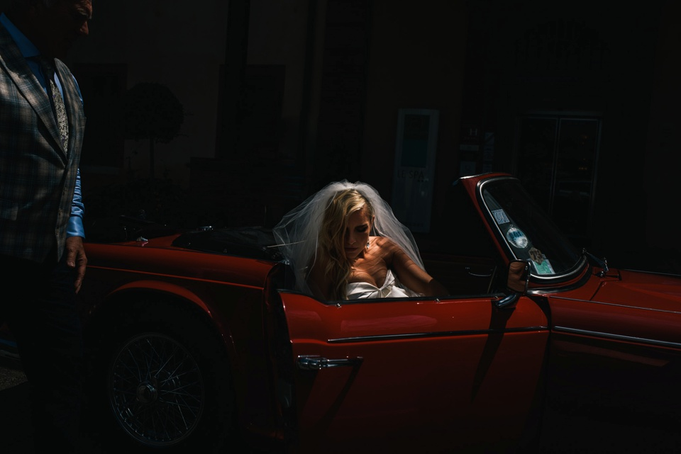 bride gets in to classic car in France