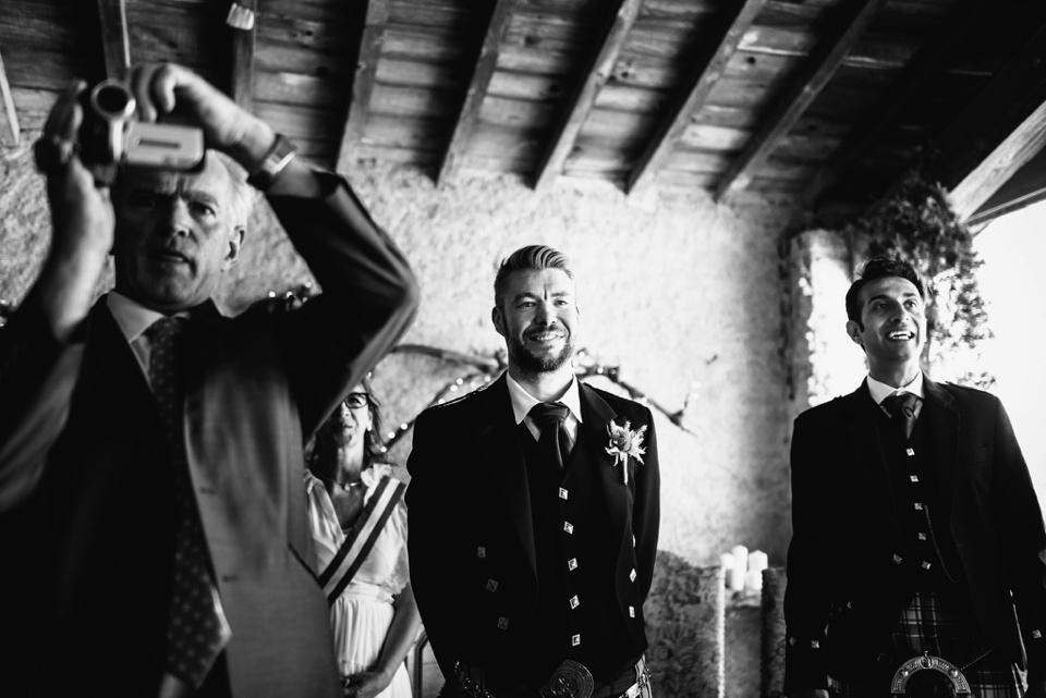 groom tearful as he sees bride walk down aisle