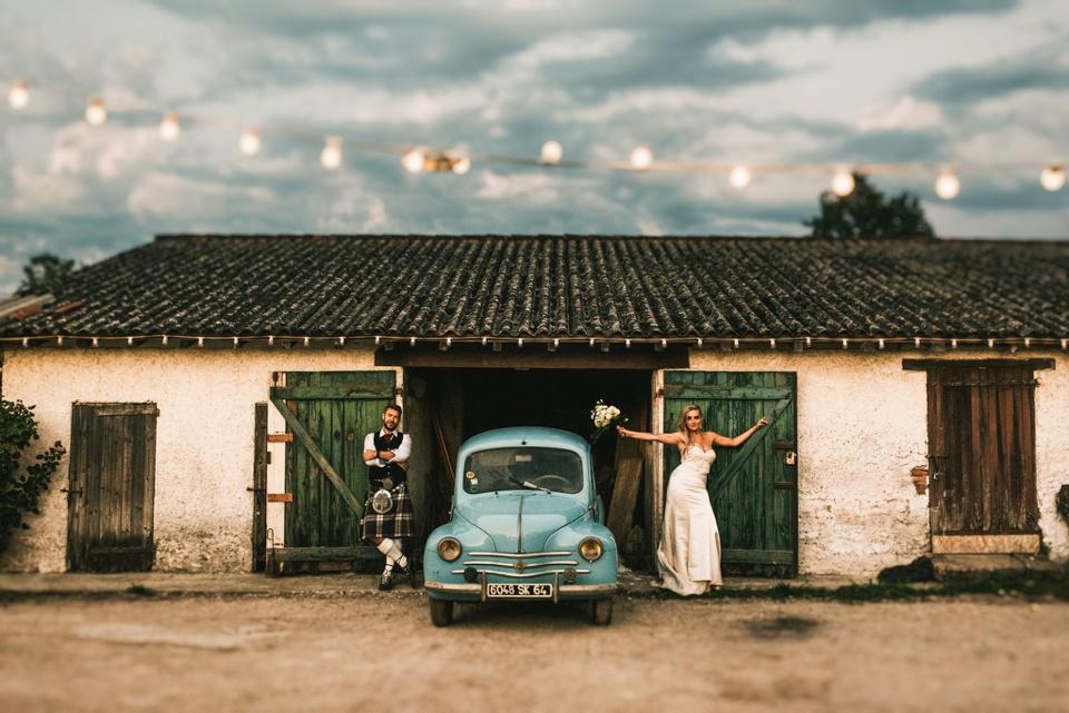classic french car wedding portrait