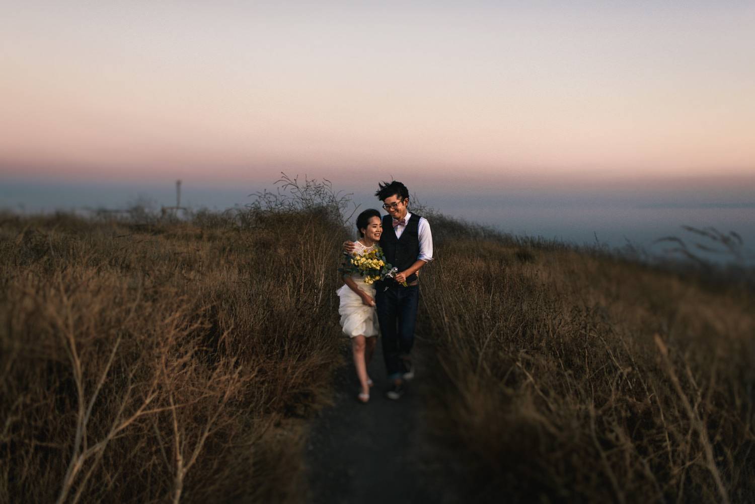 married couple walking together in the wind - Best LA Wedding Photography