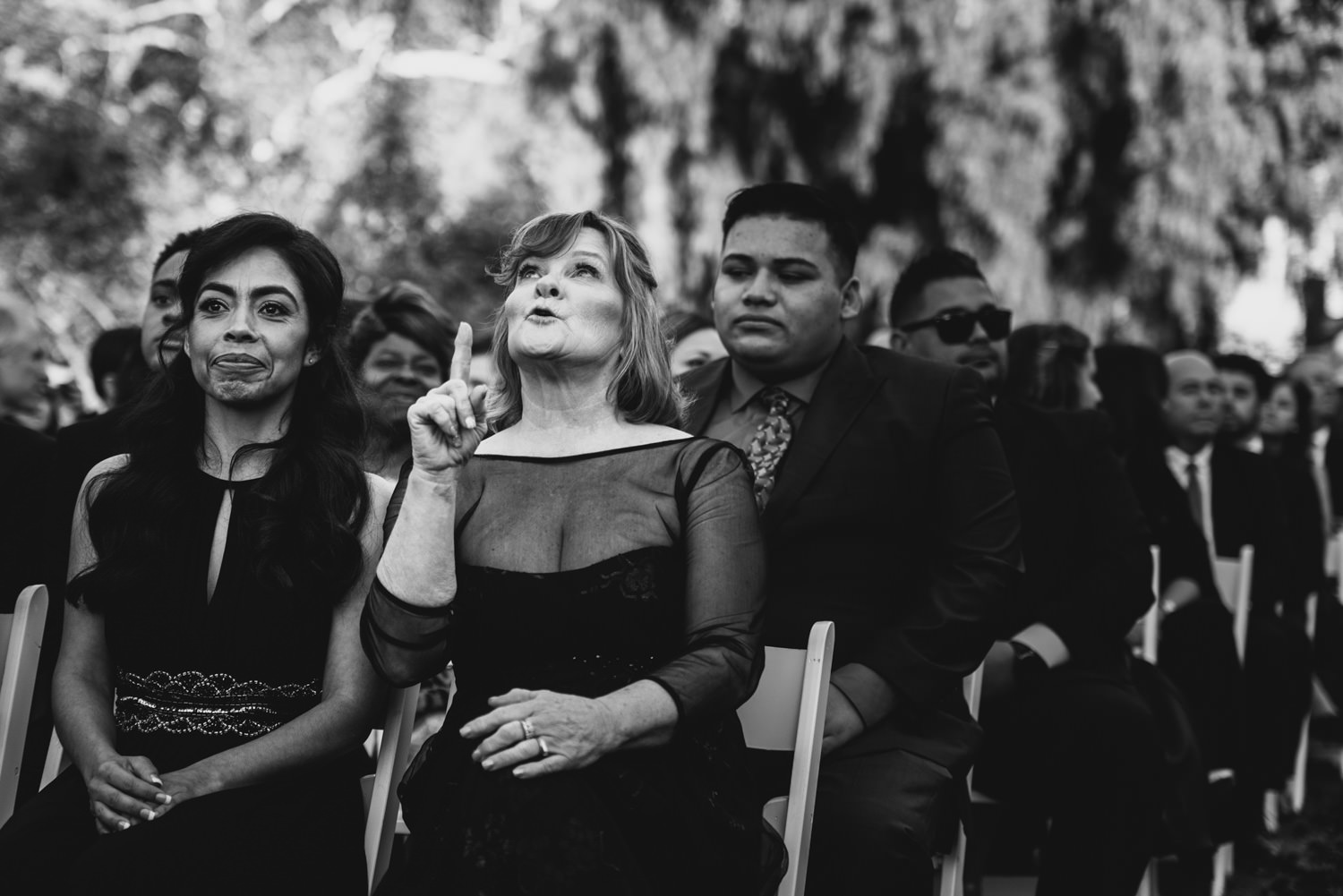 mother of groom points to the heavens - Best LA Wedding Photography