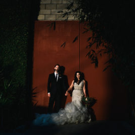smog shoppe wedding couple in front of red door