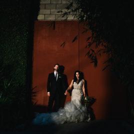smog shoppe wedding couple in front of red door