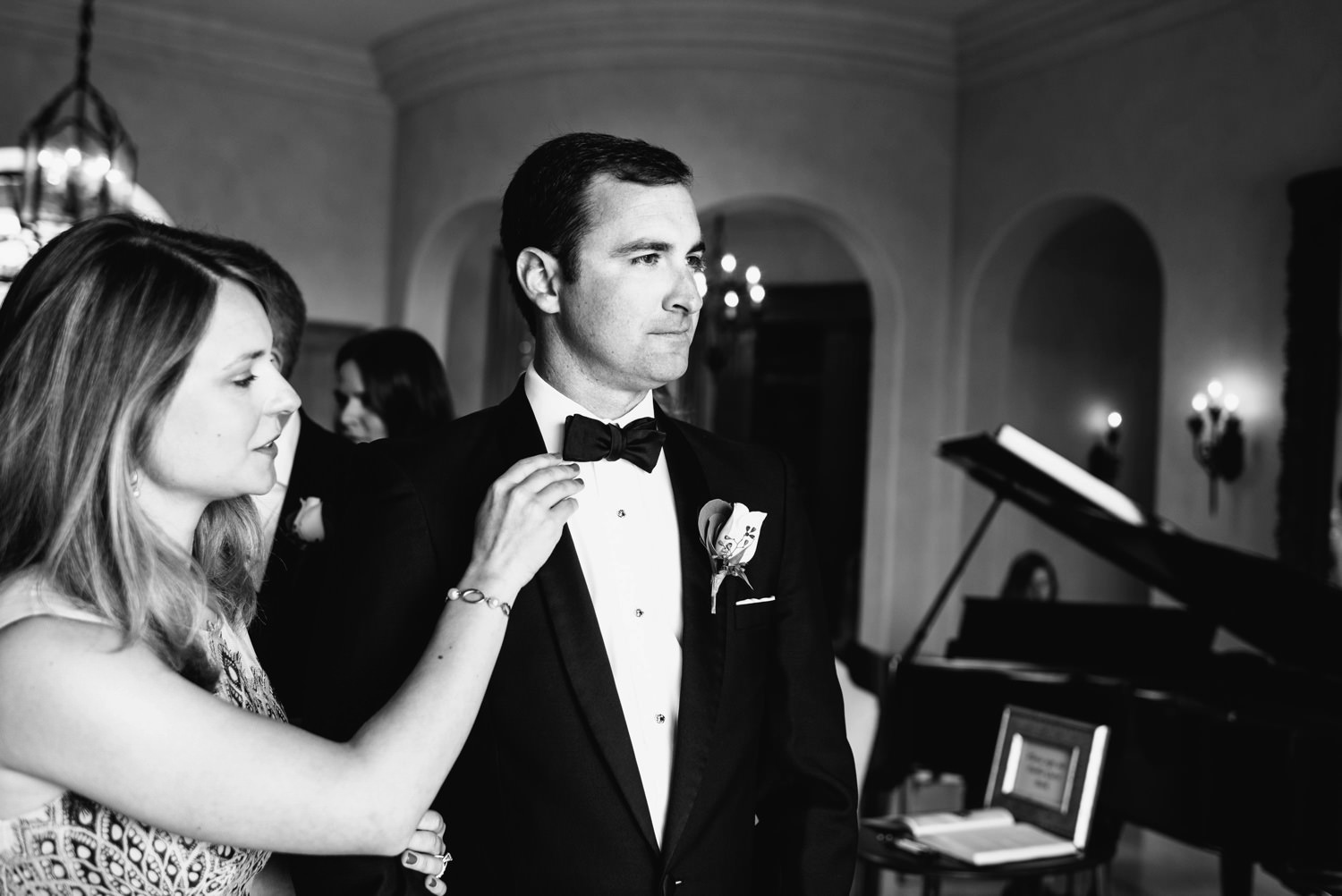 wife checks tie of husband before bridal procession - montecito wedding photography