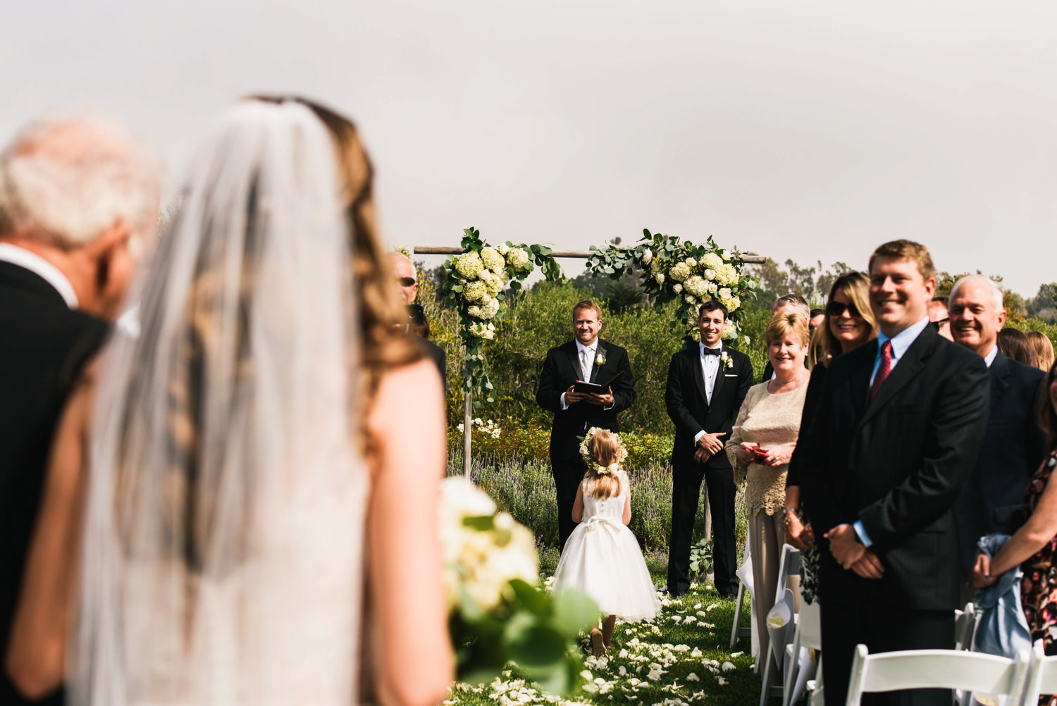 groom smiles back at bride as she approaches - montecito wedding photography