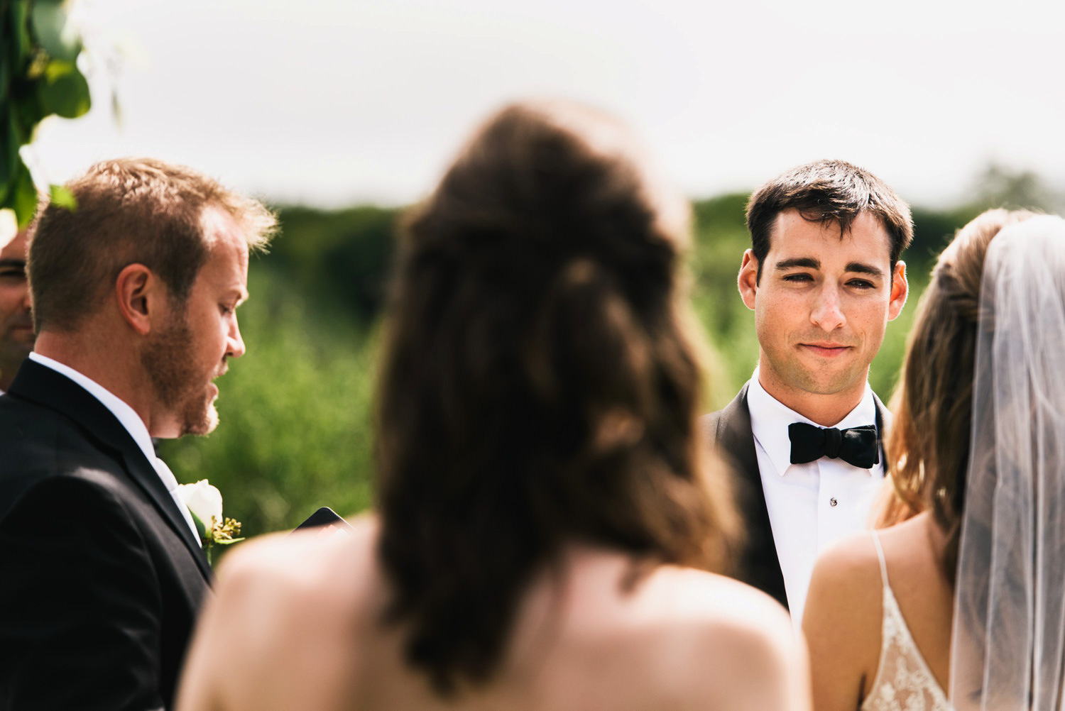 groom cant stop looking at his wife-to-be - montecito wedding photography