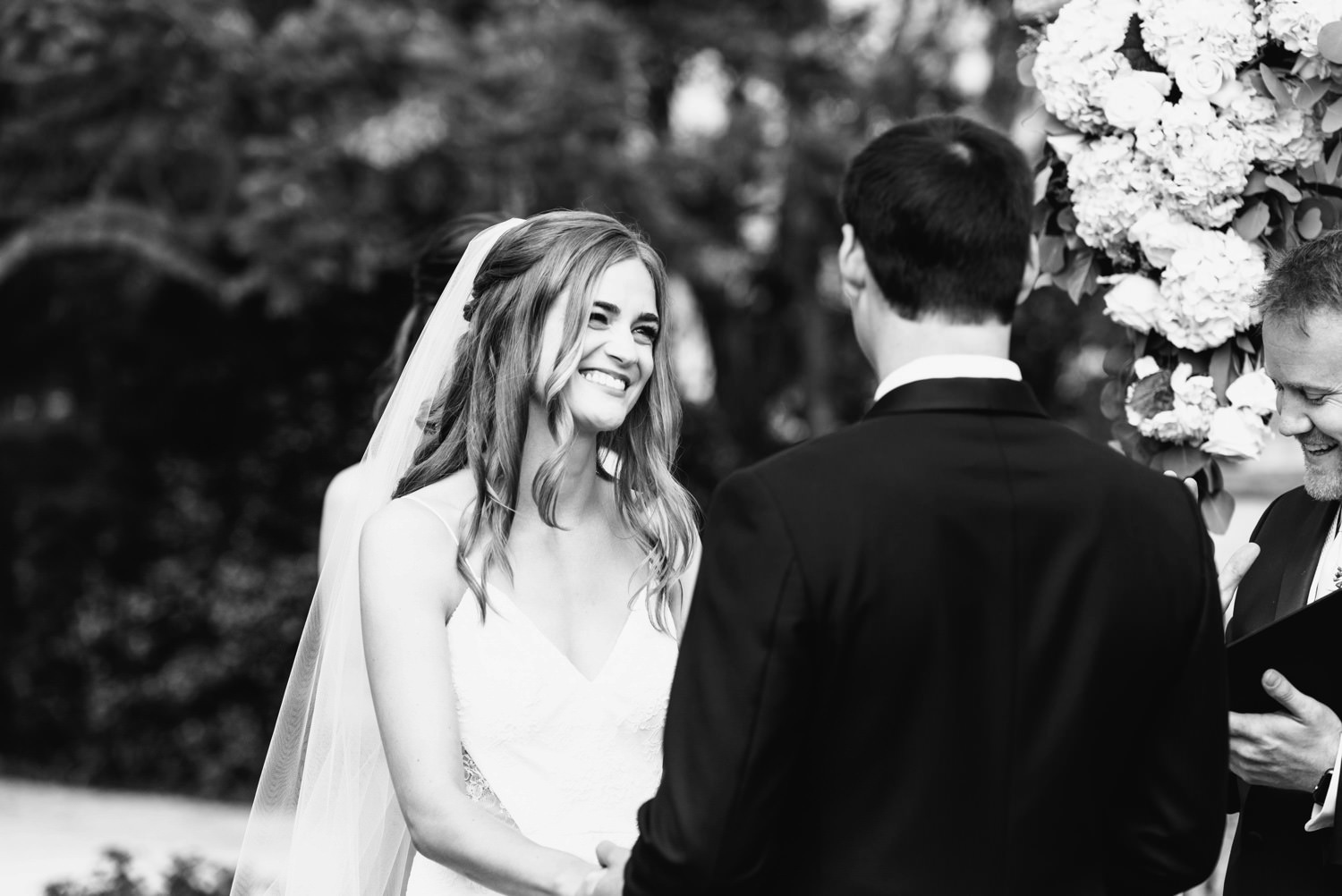 bride smiling at groom as vows are read - montecito wedding photography
