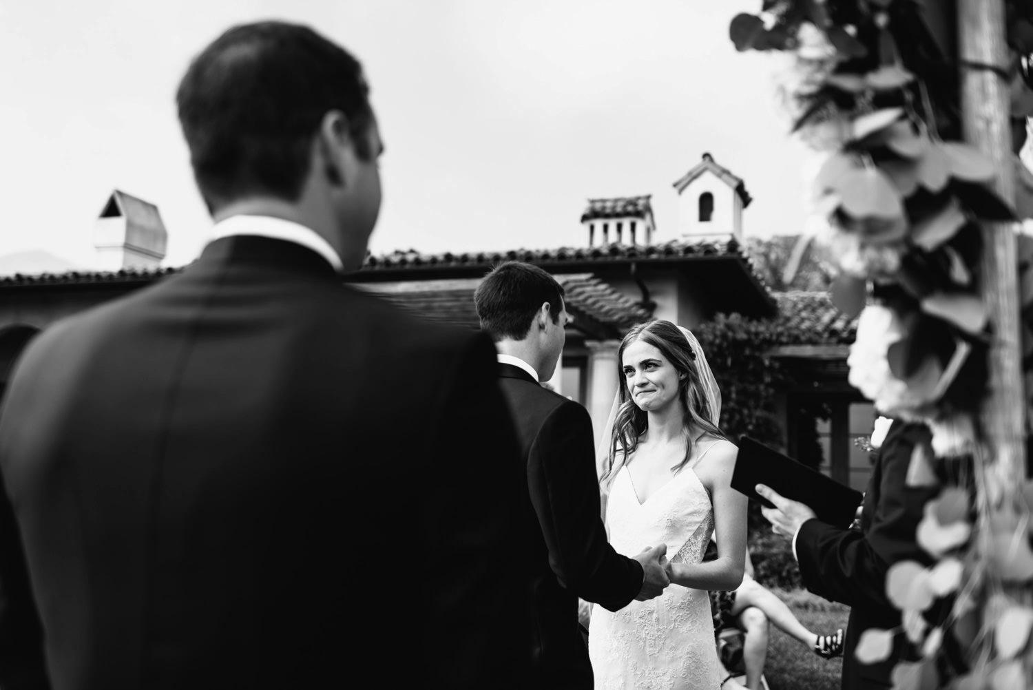 emotional smile from bride as she holds groom hands - montecito wedding photography