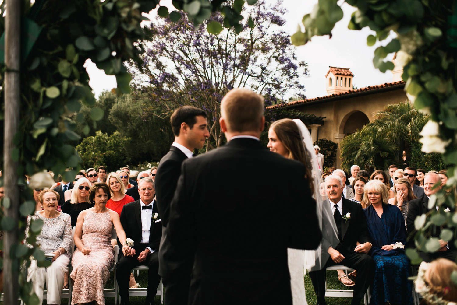 ceremony shot of family in the background - montecito wedding photography