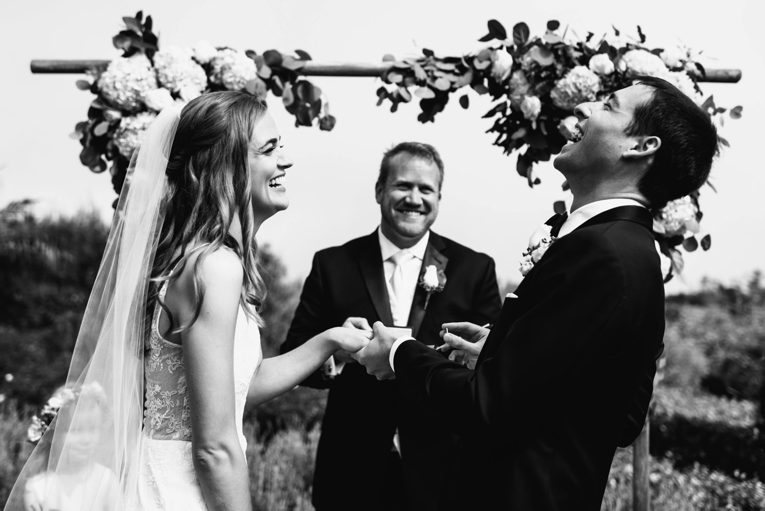 hysterical laughing as couple place rings on fingers - montecito wedding photography
