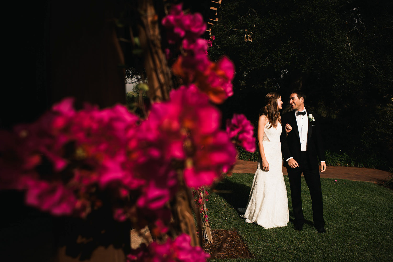 couple laugh privately before grand entrance - montecito wedding photography