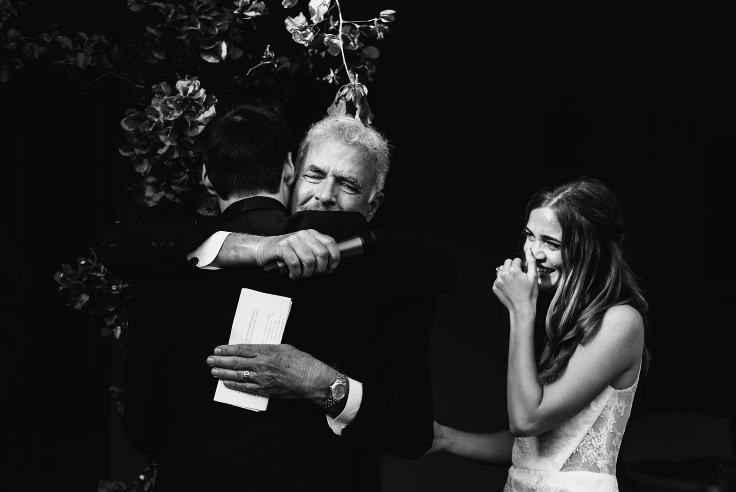 bride cries as her father hugs groom - montecito wedding photography