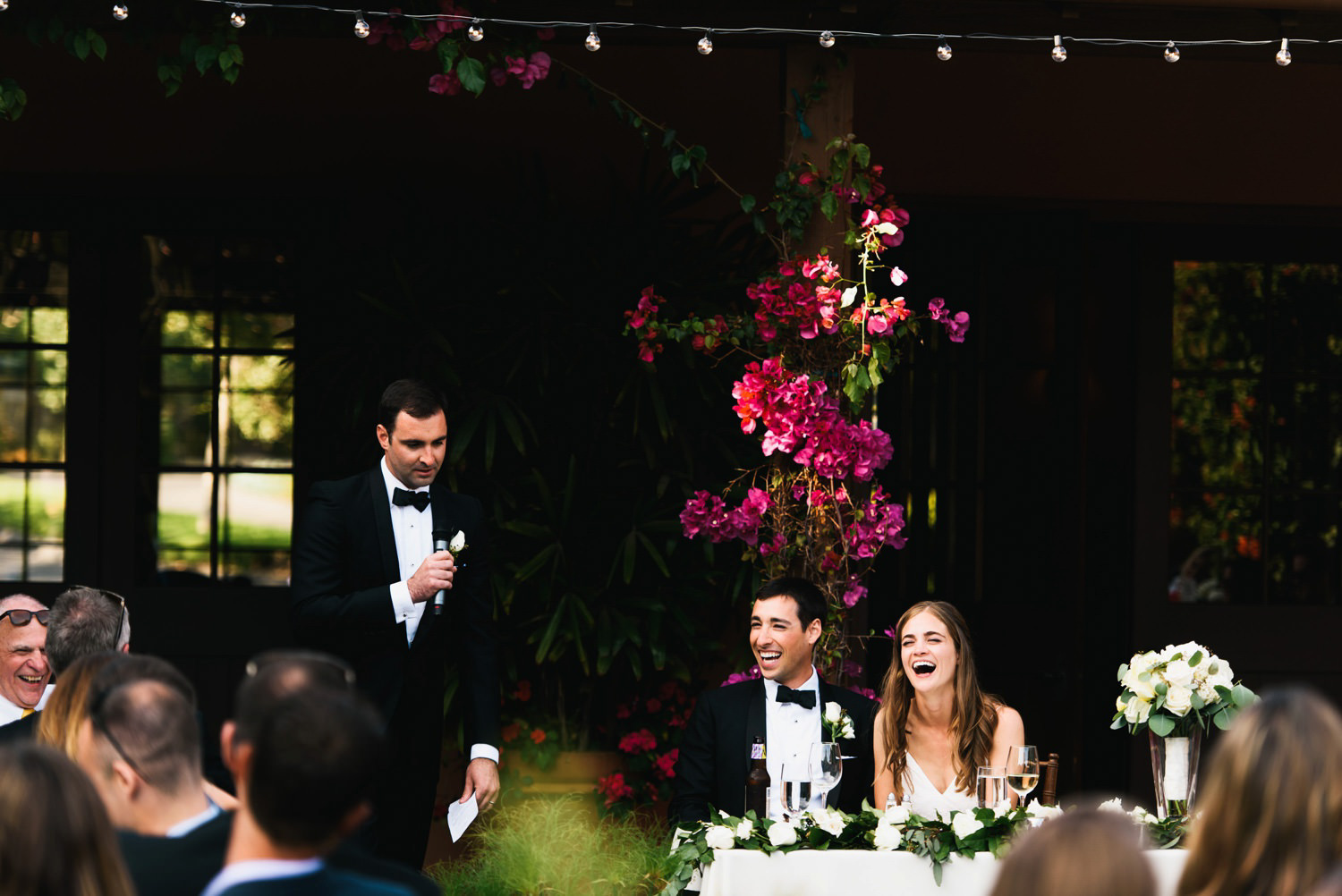 couple laugh at bestman and brothers toast - montecito wedding photography