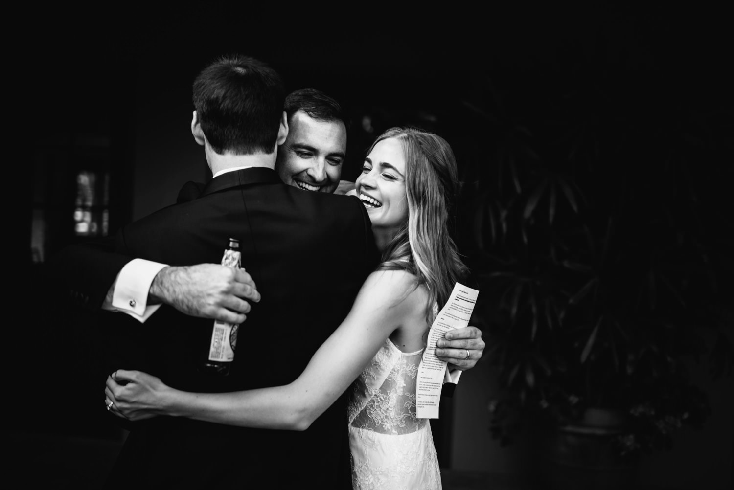 brother of groom hugs couple after toast - montecito wedding photography