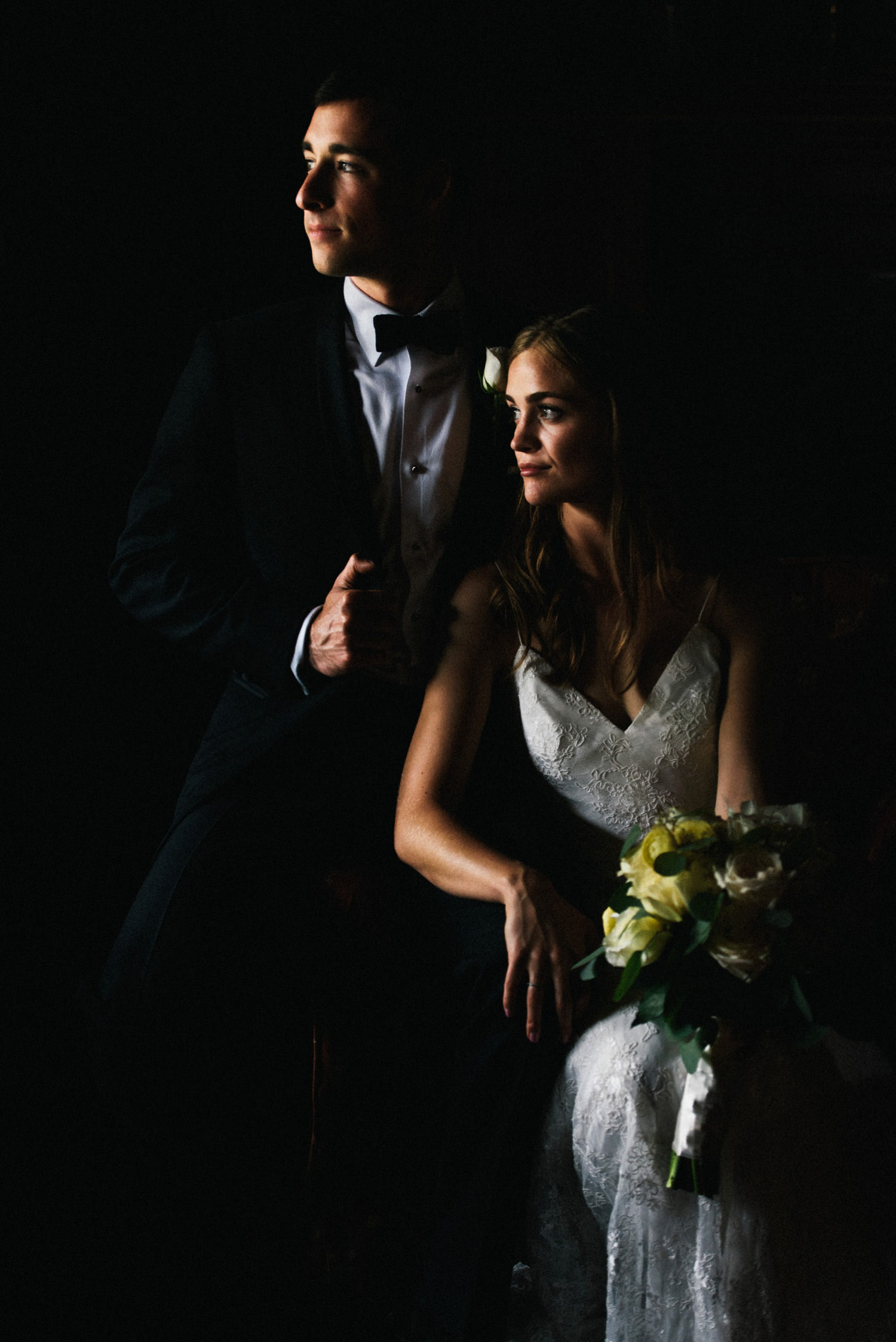 couple stare out of winder in classic portrait - montecito wedding photography