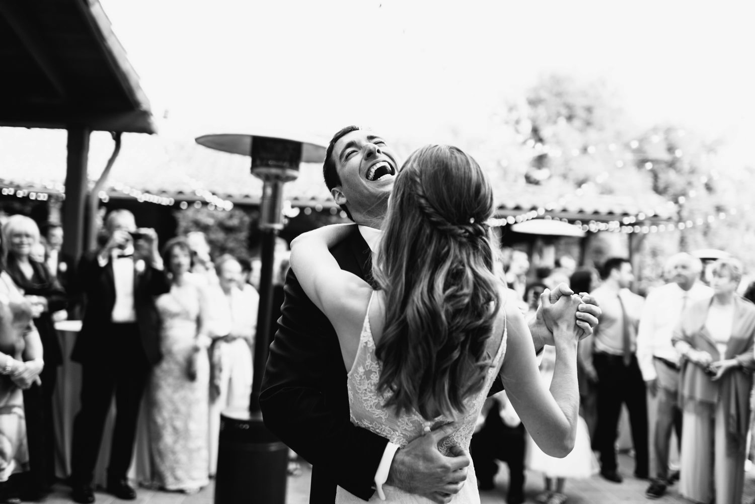 happy groom dances with wife - montecito wedding photography