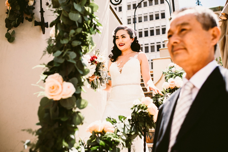 bride makes entrance at oviatt penthouse