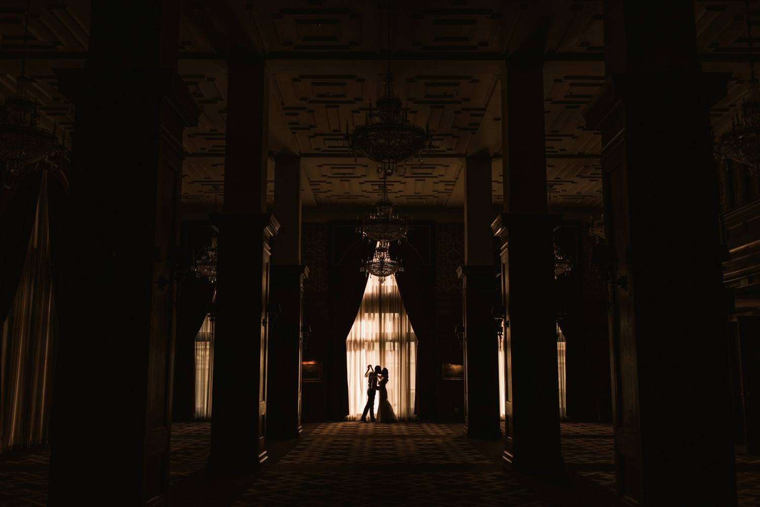 dramatic couple portrait in ballroom of la athletic club