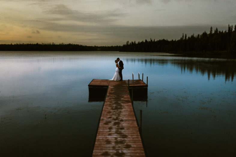 dusk portrait of married couple by alaskan lake